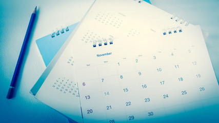 Blurred calendar in white tone.