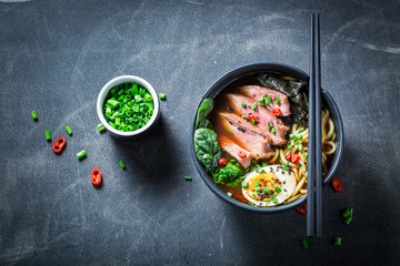 Tasty Ramen soup with noodles and spinach