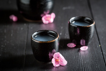 Delicious and good sake with blooming flowers