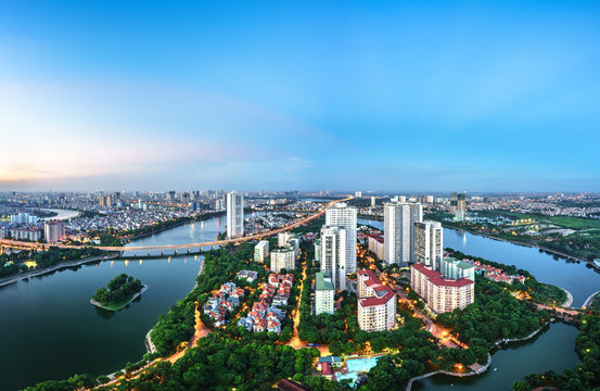 Aerial skyline view of Hanoi cityscape at twilight. Linh Dam peninsula, Hoang Mai district, Hanoi, Vietnam