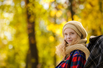 teenager girl in autumn park