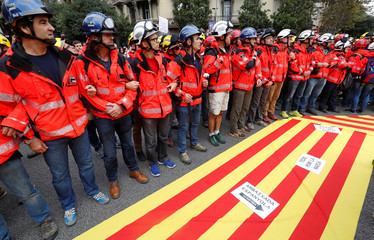 Firefighters attend a protest against police actions during the banned independence referendum in Barcelona