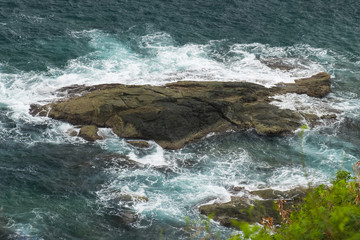 Sea waves crashing over rocks