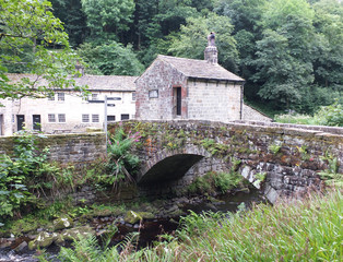 bridge and buildings at gibson mill in hardcastle crags west yorkshire