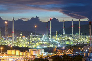 Oil refinery, oil factory, petrochemical plant in twilight with colorful sky.