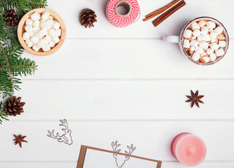 Hot chocolate and other Christmas accessories on the white table