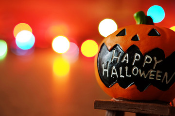 """Decorate Pumpkin Massage """"Happy Halloween"""" LED Light,For Halloween Holiday Concept,Vintage tone,Selective focus,Have copy space"""