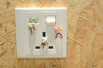 Mini of climbers climbing the Electric socket