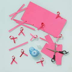 Crafting pink cancer ribbons from paper sheet