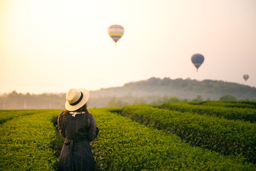 Woman is traveling at balloon festival.