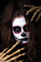 Halloween - Terrifiying Portrait of a zombie girl - Red, black and white make up - black background