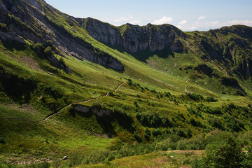 Wall Mural - Beautiful green mountain landscape with bright blue sky. North Caucasus.