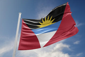 Antigua and Barbuda Flag is Waving Against Blue Sky