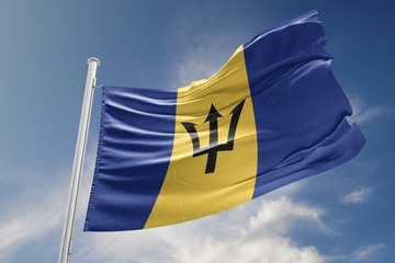 Barbados Flag is Waving Against Blue Sky