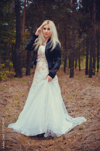 A runaway bride in a wedding dress and a leather jacket in