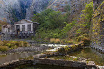 house in the mountains by the river
