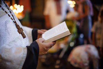 Priest Holding A Bible. Orthodox christian priest reading church book