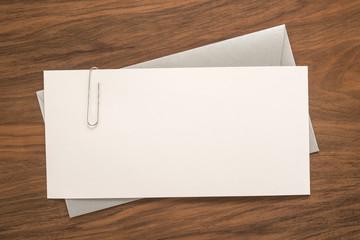 Envelope on wooden background