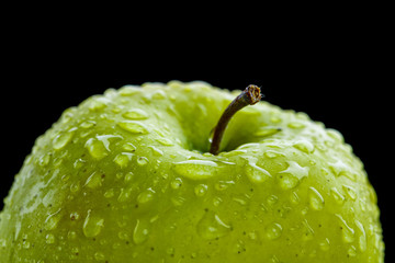 Closeup of the green apple with drops of watter