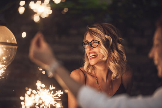 Blond woman laughing at party