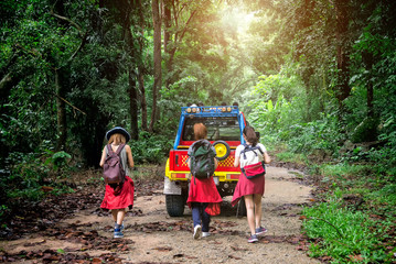 Group of Young Asian Traveling Backpacker Road Trip Walking to Adventure in the Forest Chonburi , Thailand
