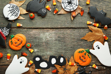 Halloween gingerbread cookies and candies on wooden table