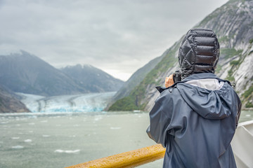 cruise ship with visitor taking photo of a glacier in glacier bay national park in Alaska