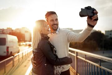 Tourist couple taking selfies