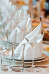 Served table with glasses and plates in the restaurant