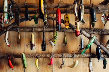 Various fishing tackles on a rack at a cabin