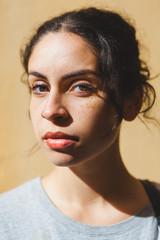 Closeup Portrait of a Beautiful Mixed Race Girl under the Sun