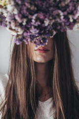 Portrait of a beautiful woman with flowers in front of her head