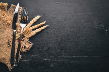Cutlery. On a wooden background. Top view. Free space for text.