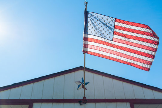 American flag waving on a sunny day.