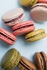Colorful macaroons on a blue background