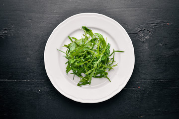 Lettuce. On a wooden background. Top view. Free space for text.
