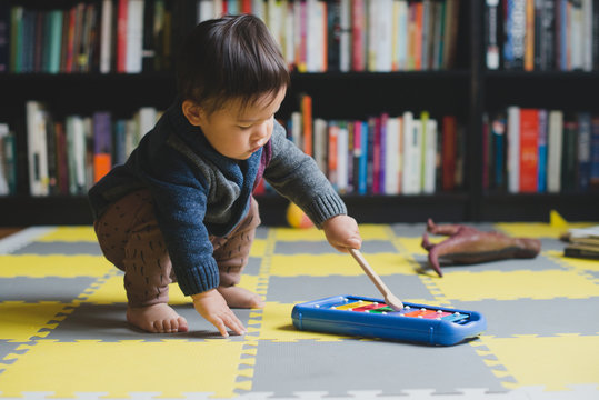 Toddler playing with glockenspiel