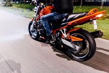 Man riding a motorbike by night