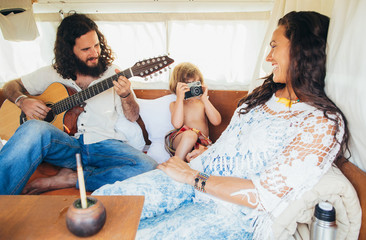 On The Road - Hippie Family of Three Enjoying Themselves in Camper Van