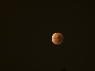 Blood Moon, Super Moon  lunar eclipse, red moon eclipse with aircraft crossing