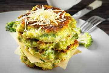 Delicious broccoli pancakes on plate, close up