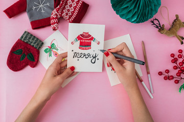 Woman Drawing Holiday Illustration on a Christmas Cards