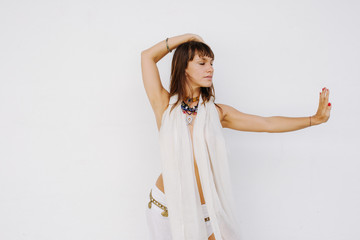 Beautiful Woman Dancing Against White Wall