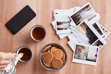 tea time: tea, cookies, mobile phone and some s