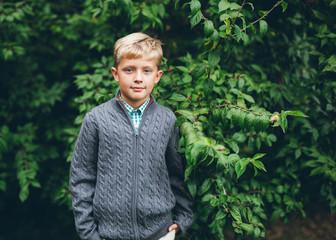 outdoor autumn portrait of a handsome boy