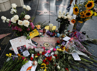 The star of Tom Petty and the Heartbreakers is adorned with flowers and other items on the Hollywood Walk of Fame in Los Angeles