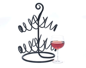 Red pomegranate wine in glass and metal wine bottle holder isolated on white background