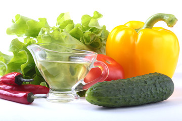 Assorted vegetables, fresh bell pepper, tomato, chilli pepper, cucumber, olive oil and lettuce isolated on white background. Selective focus.