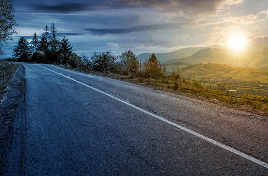 time change concept of countryside mountain road . lovely autumnal scenery