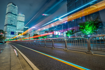light trails in the downtown district of shanghai, china.